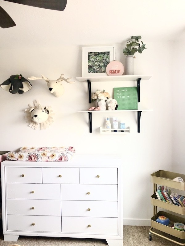 Cute nursery for a new grand baby - white dresser, shelving, gold storage